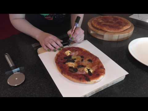 Cutting an oval pizza into equal area slices