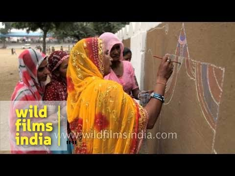 Mandana wall paintings on Rajasthani village walls