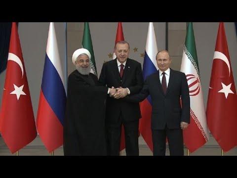 Iran, Russia, Turkey leaders begin summit on Syria: family photo