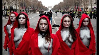Topless 'Mariannes' confront police during