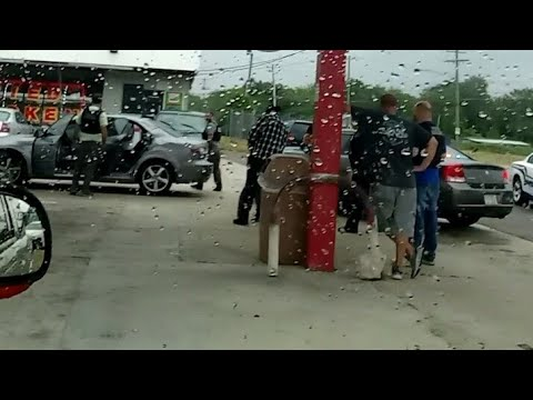 K-9sniffing people coming out corner store in Fayetteville nc