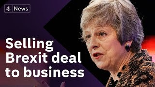May defends her Brexit deal to business leaders