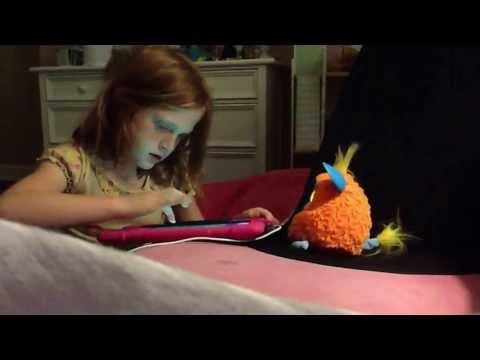 Hannah putting her Furby to sleep