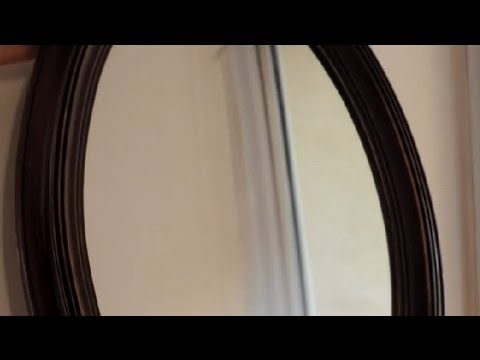 How to Hang a Heavy Mirror on a Thick Wall : How to repair your home