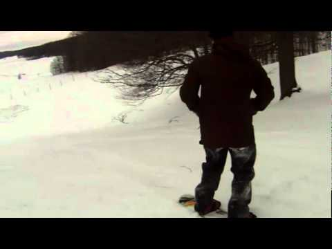Abe snowboarding in shoes
