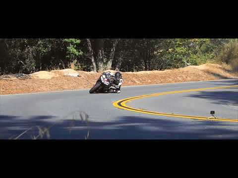 Side Show-2 Yamaha R1 power sliding in the canyons with dunlop race rubber