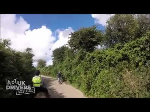 Idiot car driver does not slow down for horse riders. Road Rage UK