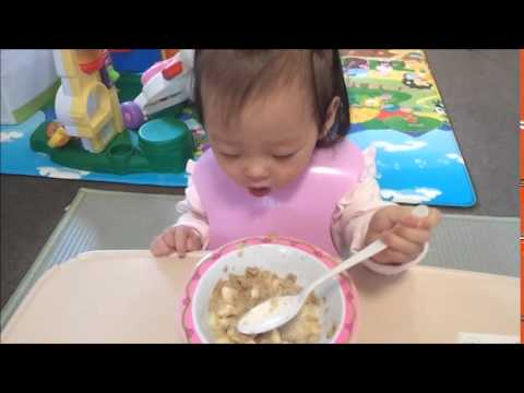 Baby eating breakfast : 16 months