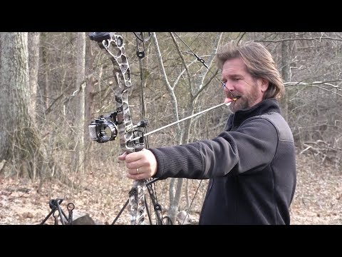 Tim Farmer Shooting a Bow With His Teeth