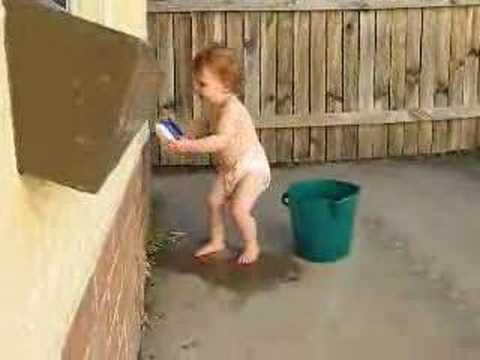 Brooke scrubbing the wall