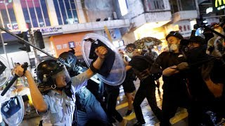 Hong Kong police draw guns on pro-democracy protesters