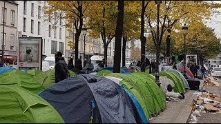 Migrant camps emerge in Paris after Calais