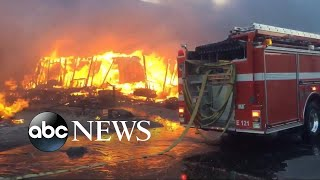 Thousands of firefighters battle 6 major wildfires