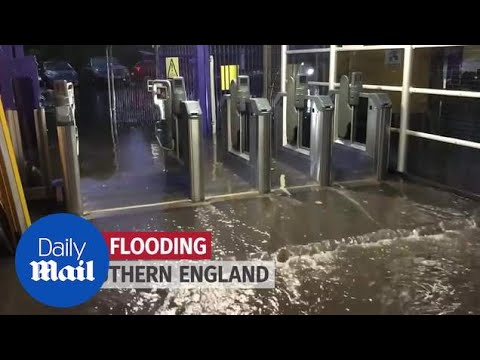 Flash floods hit southern England causing travel chaos - Daily Mail