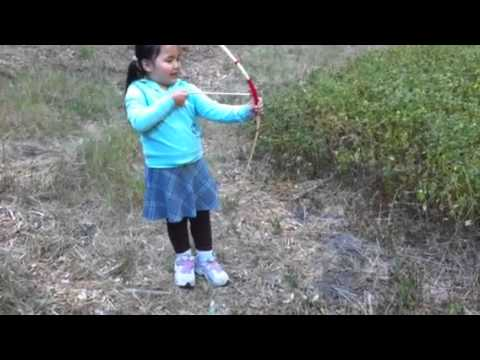 Kids learning to shoot bow and arrow