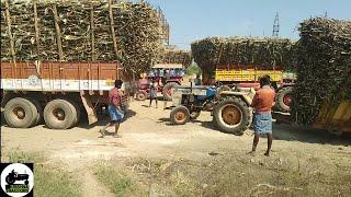 Swaraj 735 stuck in mud with sugarcane trolley