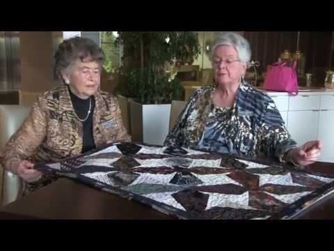 Shirley Kuser and Carol Vardeman describe quilt made from ties