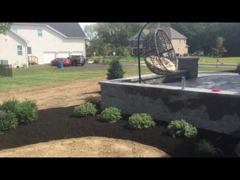 Cambridge Raised Paver Patio, Walkway and Walls. Landscape lighting by Kichler.