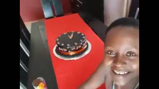Kansiime Anne cuts the new years cake.