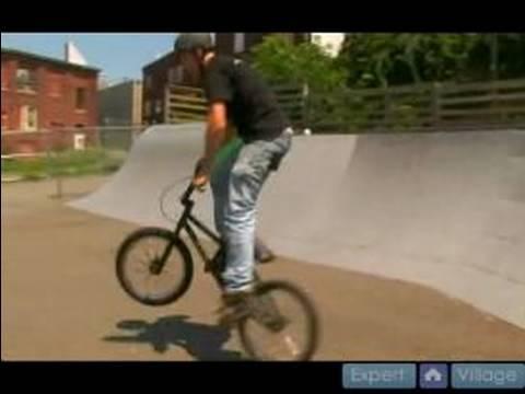 Basic Freestyle BMX Tricks : Turning Around & Doing Half Cabs on a BMX Bike