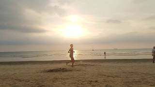 Sunset in Thailand - Beautiful sunset with people walking by