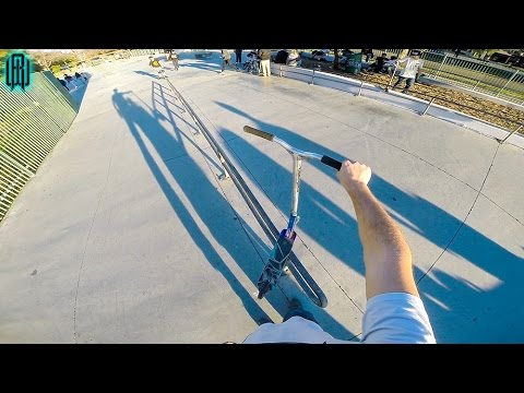 LONGEST RAIL GRIND IN SKATE PARK ON SCOOTER!