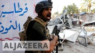 Street battles rage in Mosul suburbs as ISIL hits back