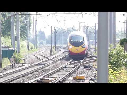 Virgin train passes through Carnforth Railway Station BR at high speed UK