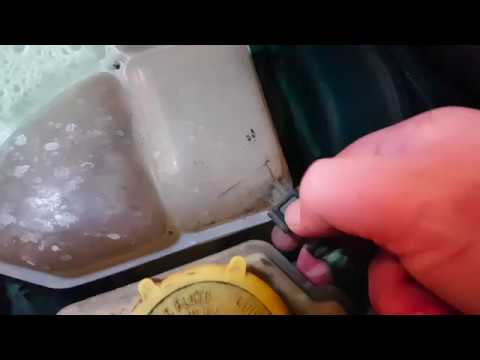 How to replace the Coolant Expansion tank on a Ford Fiesta