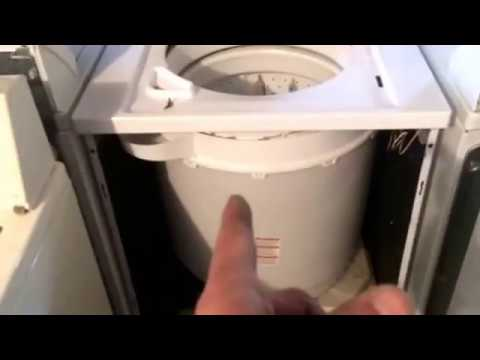 Frigidaire kenmore stacked laundry center combo washer transmission tear down repair removal