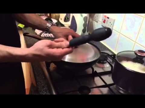 How to remove the lid  stuck on pan.
