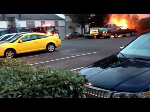 Truck on fire, guy pissed off.