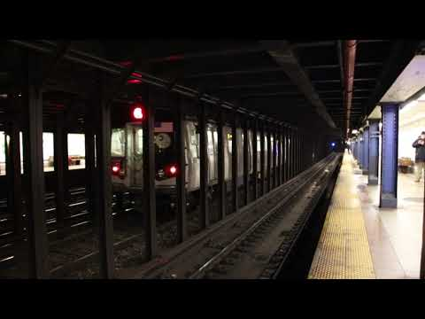 MTA NYC Subway Q trains passing 8th St/NYU