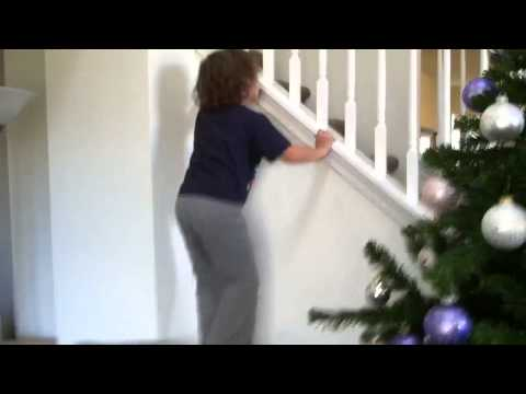 Christian climbs wall