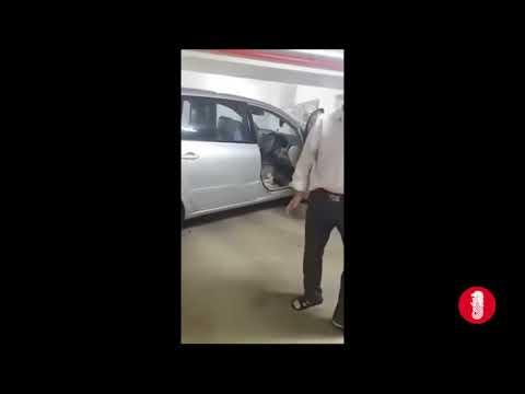 Car rammed over carpark system at HDB carpark