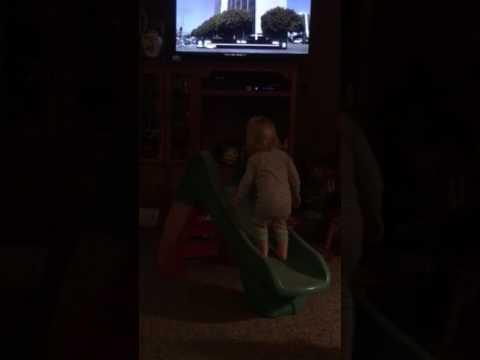 Kenzie falls off slide.  😥