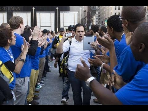 Apple fans rush to buy new iPhones at the Apple Store on Fifth Avenue in New York