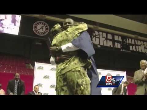 Soldier mom surprises son receiving high school diploma