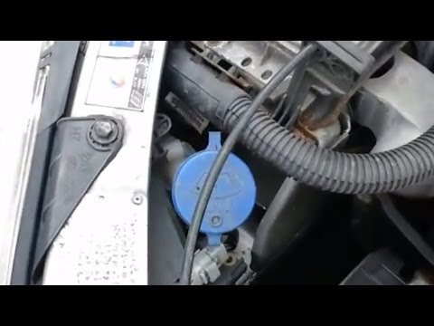 How to remove the Screenwash filler pipe on a Peugeot 206