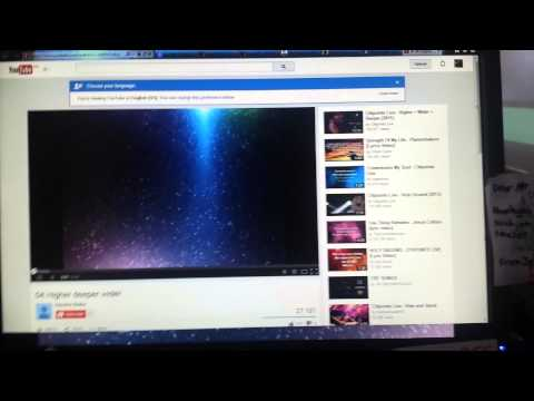 Video playing in full screen behind Web browser