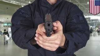 Dumb gun accident: cop practicing quick draw skills fires gun inside airport - TomoNews