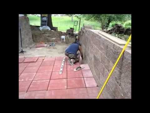 Dad and I working on our backyard laying down paver bricks