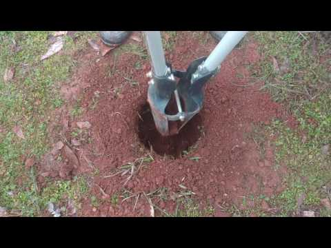 Digging post holes for the box garden