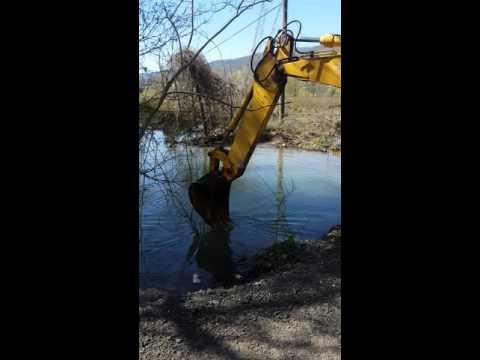 Removing a beaver dam.