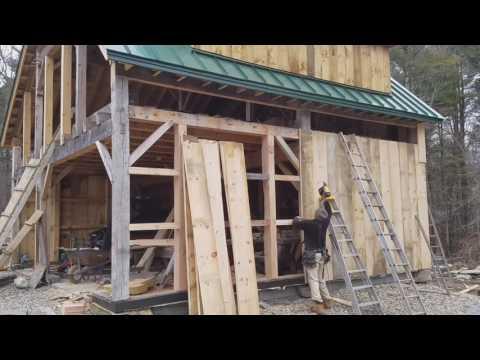 Christopher LaMontagne installing barn board siding
