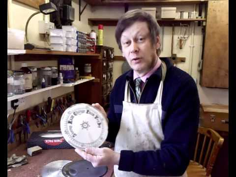 Cleaning a barometer dial