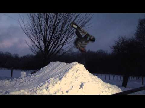 Learning how to do a BackFlip on a Snowboard ( wildcat )