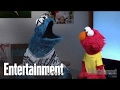 Elmo And Cookie Monster Visit Entertainment Weekly