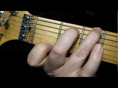 How to play guitar chords - LEFT HANDED absolute beginners guitar lesson