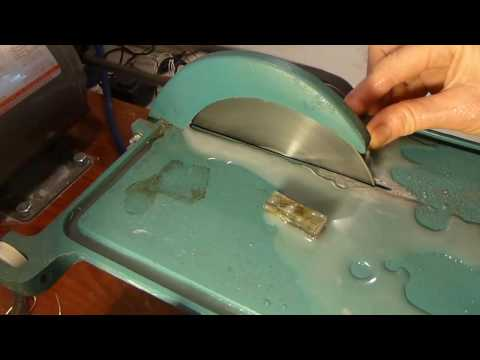 Slicing a slab of labradorite stone